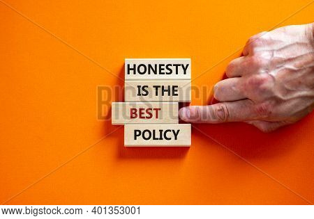 Honesty Is The Best Policy Symbol. Wooden Blocks. Text 'honesty Is The Best Policy', Businessman Han