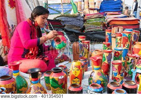 Kolkata, West Bengal, India - 31st December 2018 : Young Bengali Artist Woman Painting Colors On Ter