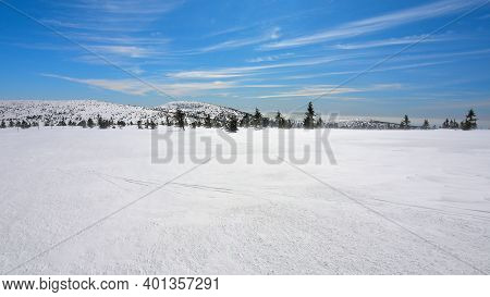 Snowy Mountain Peak With Freeze Icy Snow Cover. Amazing Flat Wintry Landscape. Clear Blue Sky.