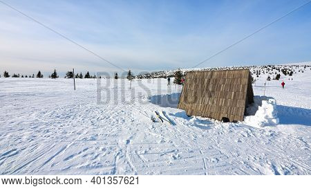 Tourists Shelter At Cross Country Skiing Way Or Path. Few Running People In The Wintry Landscape.  1