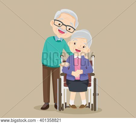 Elderly Woman Sit In A Wheelchair And The Old Man Tenderly Puts Hands On Her Shoulders. Couple Of El