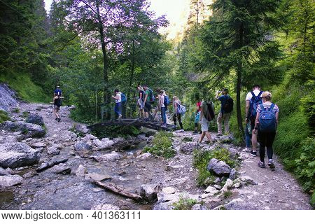 Bielsko Biala, South Poland - July 29, 2017: Bunch Of Young People Trekking Hiking In The Polish Bes