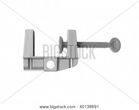 A black clamp isolated against a white background poster