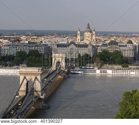 A High Angle View Of Chain Bridge And St Stephen's Basilica From Buda Castle In Budapest, Hungary