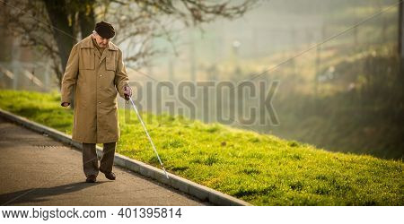 Blind man crossing a street