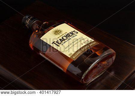 St. Petersburg, Russia - December 31,  2020: Bottle Of Teacher's Highland Cream Scotch Whiskey On Wo