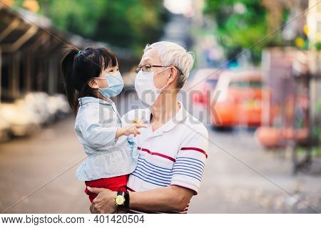 Grandfather And Granddaughter In Protective Face Mask Coronavirus Disease (covid-19). Grandfather He