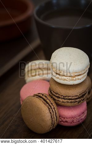 A Close Up Of A Stack Of Colourful Macaroons Or Macarons Including Pink, Chocolate And Vanilla With