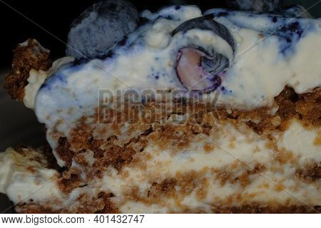 Dessert Macro Image With Blueberries On Top, Layers Of Cream And Brown Honey Dough.