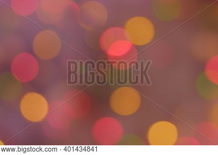 Background Of Defocused Christmas Lights On Christmas Tree Full Of Pink Color Mist.