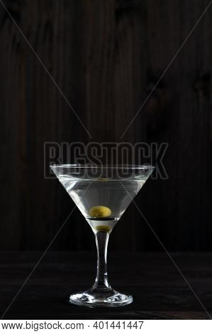 Margarita Cocktail In The Bar. Martini Glass Of Cocktail With Olives On Wooden Background. Glasses F