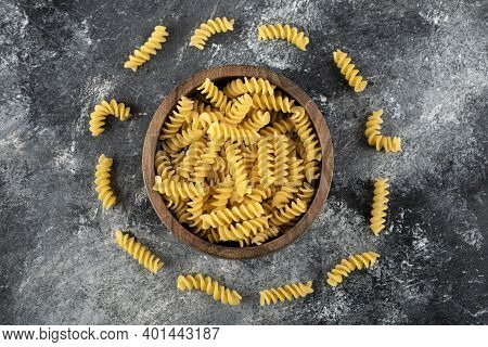 Bowl Of Fusilli Pasta On Marble Background