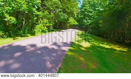 Paulding County, Ga Usa - 06 11 20: Angled Trail View And Green Foliage In The Summer Silver Comet T