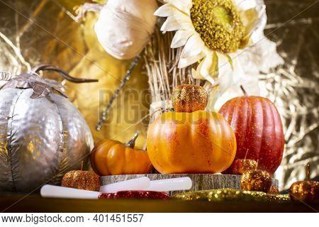 Small Orange Pumpkins, Small Red Pumpkin, Small Orange Glitter Pumpkins, A Large Silver Pumpkin, Red