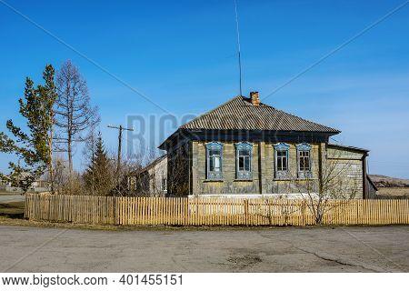 Krasnoe Village, Russia-april  18, 2014: Old Wooden House In The Siberian Village ,  Krasnoe Village