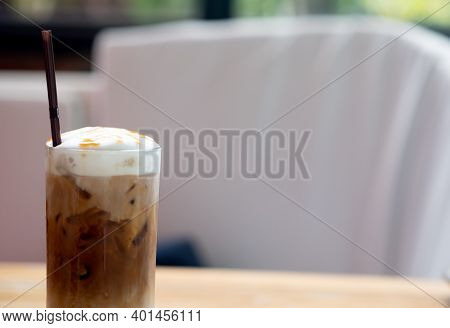 Iced Caramel Macchiato Coffee In The High Glass. Space For Text