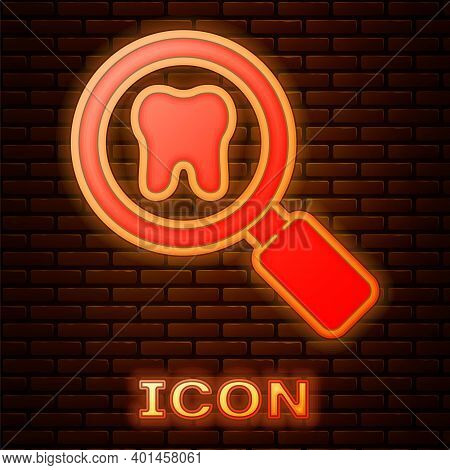 Glowing Neon Dental Search Icon Isolated On Brick Wall Background. Tooth Symbol For Dentistry Clinic