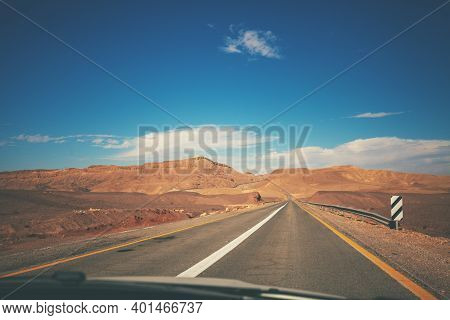 Driving A Car On Mountain Israel Road. Desert Landscape. Empty Road. View From The Car Of The Mounta