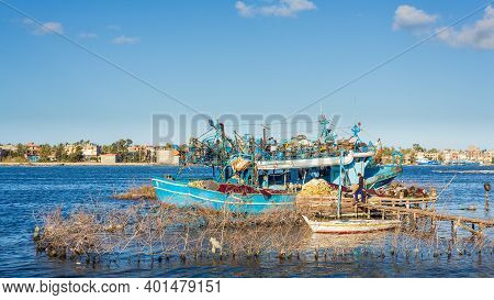 Rashid, Egypt- Feb 1 2020: Fishing Boats Parked At River Nile In Cloudy Winter Day, El Borg District