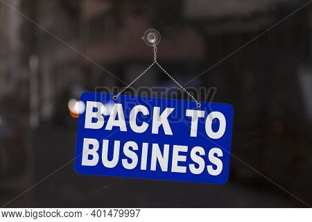 Close-up On A Blue Open Sign In The Window Of A Shop Displaying The Message