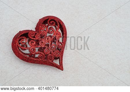 A Red Decorative Heart Isolated On A White Background