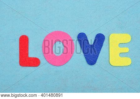 The Word Love On A Blue Background