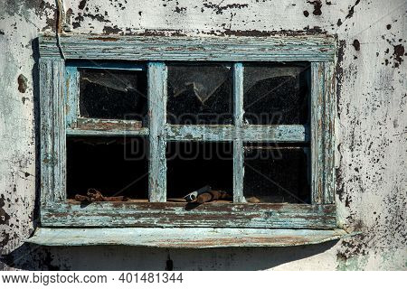 Large Old Wooden House In An Abandoned State With Broken Glass In The Windows. Now There Are Few Peo