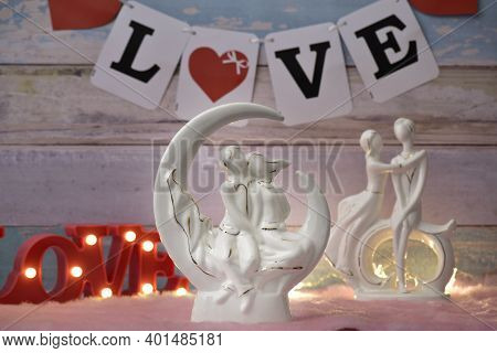 White Couple Figurine On Loving Valentine Background, Loving Couple Figurine