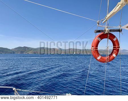 Life Preserver Ring On Boat   Sailing Waves Mountain Landscape On The Horizon   Possibility Of New H