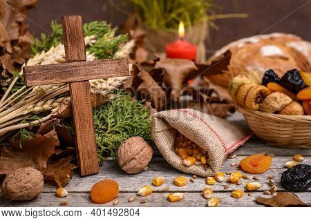 Traditional Food For Orthodox Christmas Eve. Yule Log Or Badnjak, Wooden Cross, Bread, Cereals Dried
