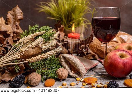 Traditional Food For Orthodox Christmas Eve. Yule Log Or Badnjak, Wine, Bread, Apples, Cereals, Drie