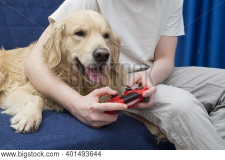 Remote Control For A Game Console.a Young Man Is Playing A Game Console.