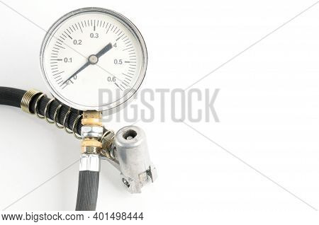 Pressure Gauge For Measuring Air Pressure In Car Tires On A White Background