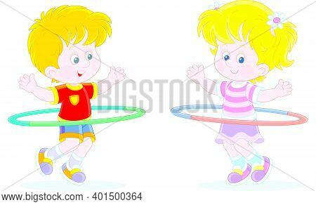 Cheerful Cute Little Kids In Colorful Sport Clothes Playing And Fun Spinning Hoops In A Gymnastic Le