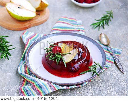 Dessert, Cherry Jelly With Pear On A Ceramic Plate On A Gray Concrete Background. Jelly Recipes. Len
