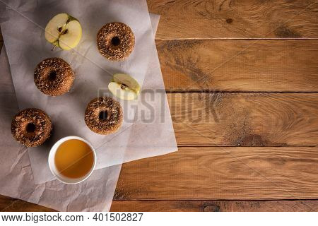 Baked Donuts With Apple Cider And Apple Fruits On Baking Sheets On Natural Wooden Table. Ready To Ea