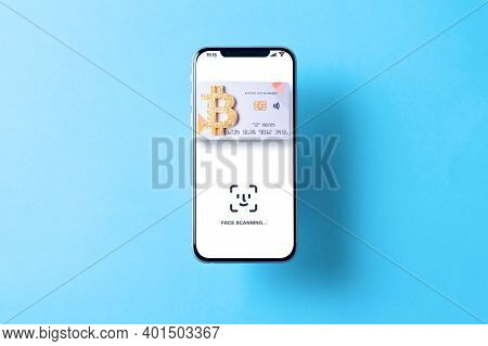 Bitcoin Paying Symbol. Bank Bitcoin Cryptocurrency Card In Hovering Smartphone Screen. Shopping And