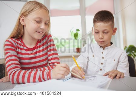 Childhood, Leisure Concept. Adorable Kids Drawing Together During Art Class. Happy Healthy Kids Deve
