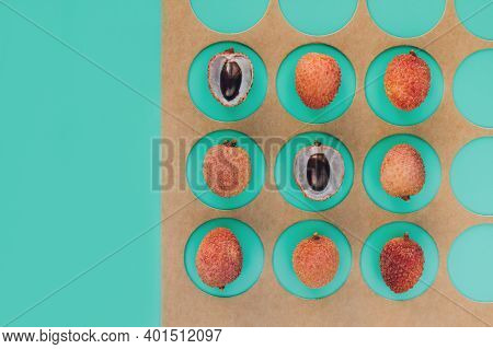 Tropical Fruits - Lychee Or Litchi On Light Green Background With Copy Space. Trendy Geometric Compo