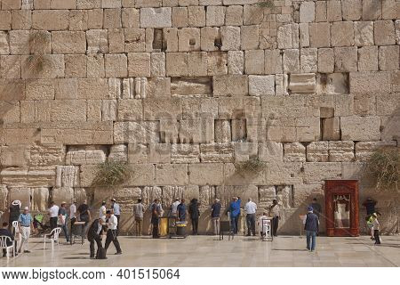 People Praying At The Western 'wailing' Wall Of Ancient Temple In Jerusalem. The Wall Is The Most Sa