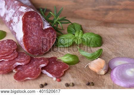 Slices Of Delicious Spanish Sausage Fuet On The Wooden Natural Kitchen Board Closeup. Love Food Conc