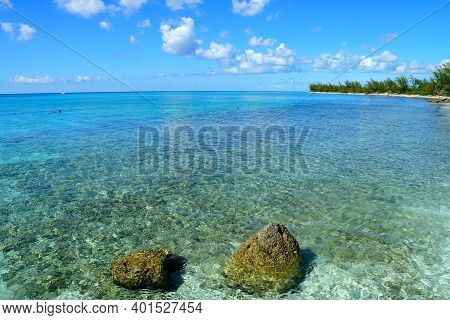 Stunning Crystal Clear Water With Corals Along The Shallow Bay At Princess Cays, Bahamas
