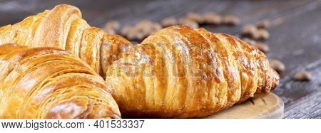 Fresh Croissants On A Wooden Background. Banner With Croissants. Homemade Croissants. Pstry And Cake
