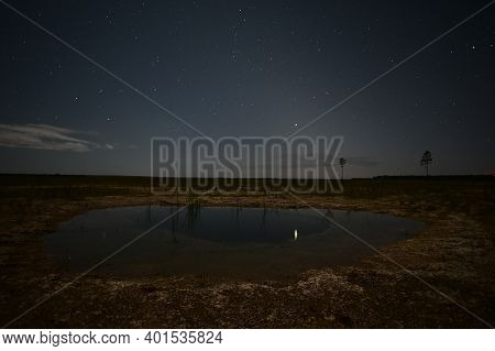 Jupiter-saturn Conjunction Over Everglades National Park, Florida Reflected In Calm Water Of Exposed