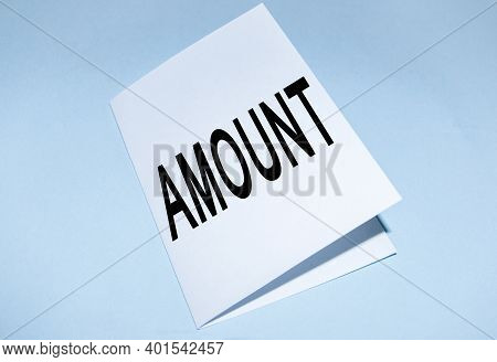 The Word Amount On White Paper Folded In Half, On A Blue Background, The Amount Of Salary At The Mom