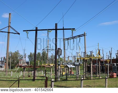 Electric Wires At A Power Plant On Poles High-voltage Voltage In A Transformer