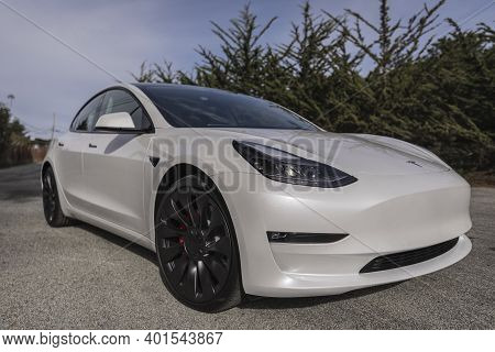 Moss Beach Usa - January 1, 2021: Pearl White Electric Tesla Model 3 Dual Motor Performance Awd Car