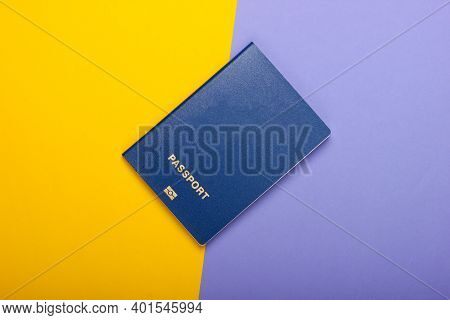 Tourism And Travel Concept. Emigration. Passport On Purple Yellow Background. Top View. Flat Lay