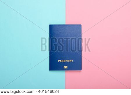 Tourism And Travel Concept. Emigration. Passport On Pink Blue Background. Top View.