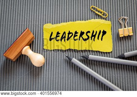Leadership. Yellow Sheet Of Paper With Text On A Gray Background